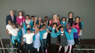 The children from Ben Jonson Primary School with teachers and volunteers